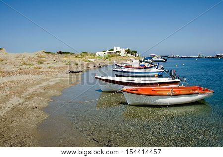 Tranquil scene os small fisherboats at the harbor of Skyros island Greece