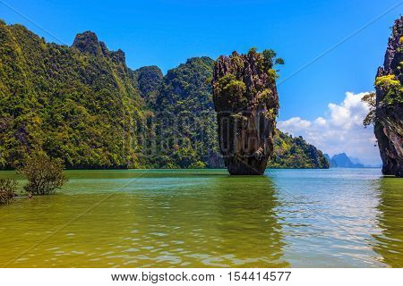 The tourist season in Thailand. Calm and warm sea and picturesque quaint island. James Bond Island