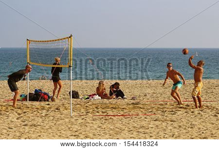 Barcelona Spain - October 30 2016: Locals and tourists playing volleyball on an untipcally warm and sunny mid autumn sunday on Bogatell beach