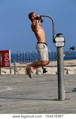 Barcelona Spain - October 30 2016: A young main doing outdoor sports on an untipcally warm and sunny mid autumn sunday on Nova Icaria beach