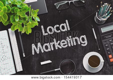 Top View of Office Desk with Stationery and Black Chalkboard with Business Concept - Local Marketing. 3d Rendering. Toned Illustration.