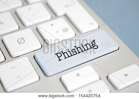 Phishing written on a keyboard