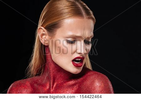 Red bodypaint. Close up portrait. body art. Black background