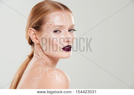 Beauty image in profile of girl with body art. Close up. Body art