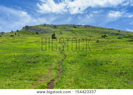 Landscape with hiking path on Chatyr-Dah mountainous massif in Crimea at spring season.