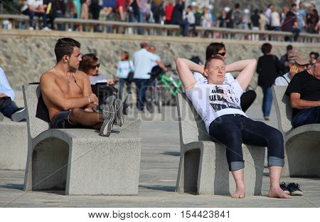 Barcelona Spain - October 30 2016: Tourists and locals enjoying an untipcally warm and sunny mid autumn sunday on a crowded Nova Icaria beach