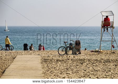 Barcelona Spain - October 30 2016: Locals and tourists enjoying an untipcally warm and sunny mid autumn sunday on Nova Icaria and Bogatell beaches