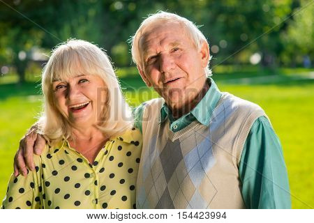 Senior man hugging woman. Old lady smiling. Years and feelings. Find love and enjoy life.