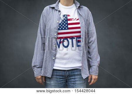 Vote Presidential Elections USA flag. Print on T-shirt political message. Selective focus.