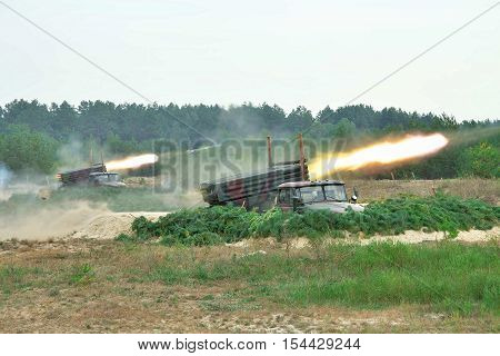 Rocket artillery firing the targets from defiladed position during military training