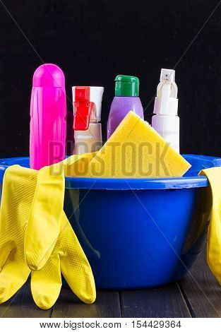 Cleaning items in bucket isolated on black