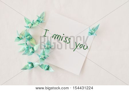 i miss you feeling message card and folded paper bird handmade