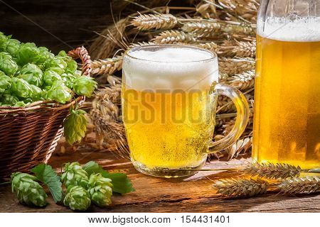 Fresh homemade beer made of hops on wooden table