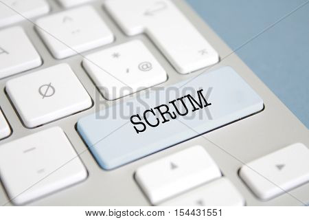 SCRUM written on a keyboard