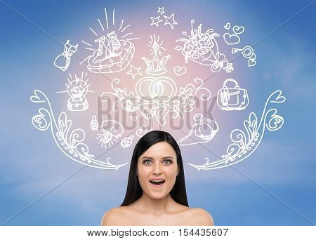 Surprised naked girl is standing against blue wall with wedding sketches on it. Concept of matrimonial ceremonies. Toned image