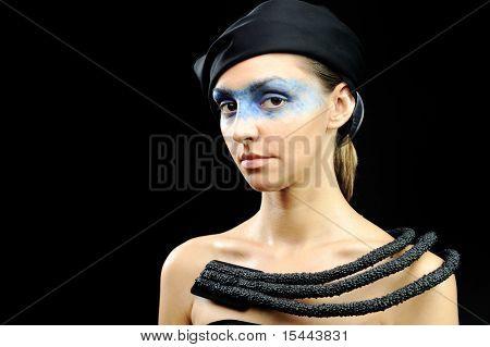Very pretty stewardess with dark  scarf, necklace, dress and colorful mask eyes, fashion stylish model