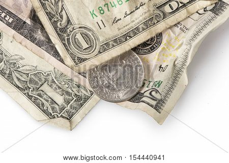 Wrinkled dollar bills and a quarter adding up to $7.25 the current (as of 2016) U.S. Federal Minimum wage. poster