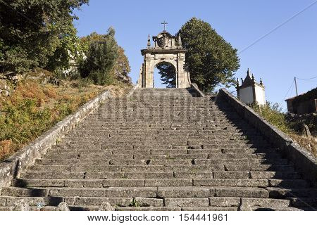Detail of the steps leading the arch gate of the alley towards the Church of Our Lady in the Peneda Geres National Park North of Portugal