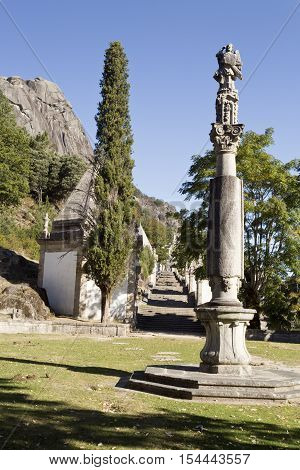 Detail of a granite column on the first plaza of the alley to the Church of Our Lady in the Peneda Geres National Park North of Portugal