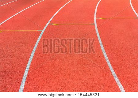 Running track texture. Running track background. Red running track at sport stadium. Athletic running track.