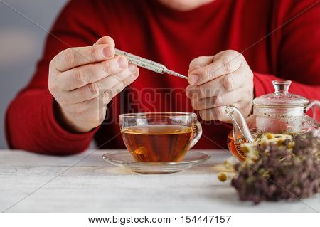 Man Cold / Ill Man With Scarf And Tea Cup, Sneezing Into Handkerchief. Medication Or Drugs Abuse, He