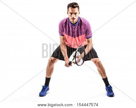 Ready to hit! Male tennis player with racket ready to hit a tennis ball isolated on white
