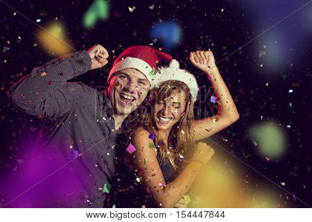 Young couple in love dancing at New Year's Eve party and having fun