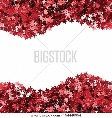 Abstract red sparkling stars on white as a background