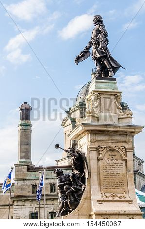 Quebec City, Canada - July 27, 2014: Champlain Monument statue on Dufferin Terrace in sunlight