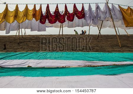 DHAKA BANGLADESH- MARCH 01 2016. Unidentified people passing a dam