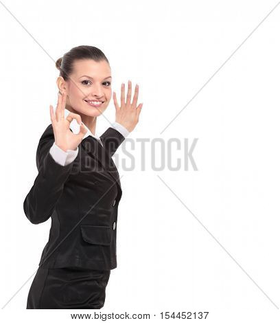 Attractive business woman is showing okay sign with happiness.