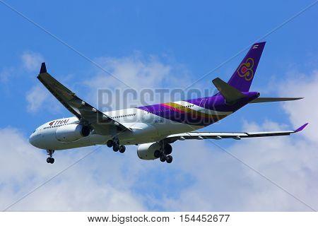 CHIANGMAI , THAILAND -APRIL 1 2014: HS-TBG Airbus A330-300 of Thaiairway. Landing to Chiangmai airport from Bangkok Suvarnabhumi.