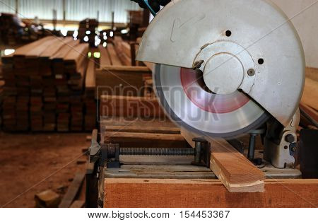 compound miter saw cutting wooden plank , Cutting wood