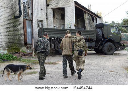 Ukraine, Lugansk region, on October 7, 2016. Soldiers hug each other. The joy of meeting.