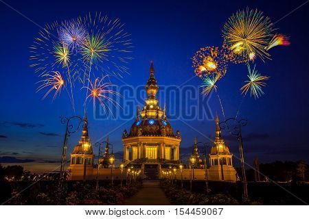 Fireworks over Buddhist Pagoda in twilight at Wat Thung Setthi Khoankaen Thailand (In Thailand Buddhist temples are all public domain)