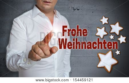 Frohe Weihnachten (in german merry christmas) touchscreen is operated by man.
