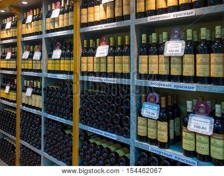 Massandra, Russia - November 09, 2015: Shelves with wine in the company shop winery Massandra Crimea