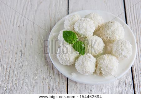 Homemade coconut candies with filling of cream and nut