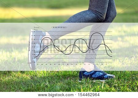 Closeup of female legs jogging at park. Graphic of training results. Health care and sport concept.