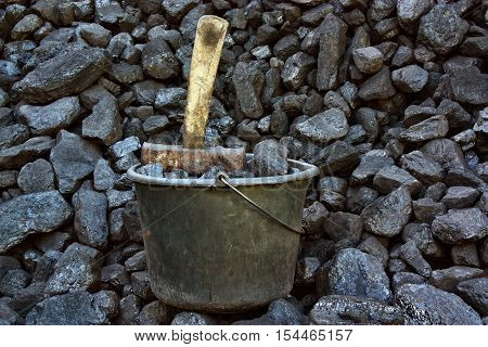Bucket coal on a background of coal mineral