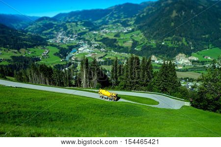 Yellow Truck On Mountain Road Tilt-shift View