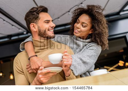 portrait of a lovable couple hugging each other and smiling, selective focus