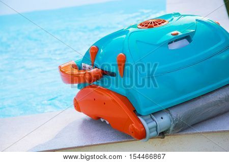 close up on Robot cleaning swimming pool