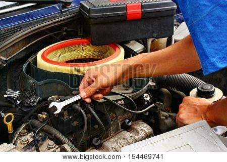 Hand of car mechanic in auto repair service station