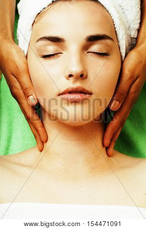 stock photo attractive lady getting spa treatment in salon, close up asian hands on face