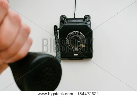 Black Retro Phone On A White Background With Rotary Dial