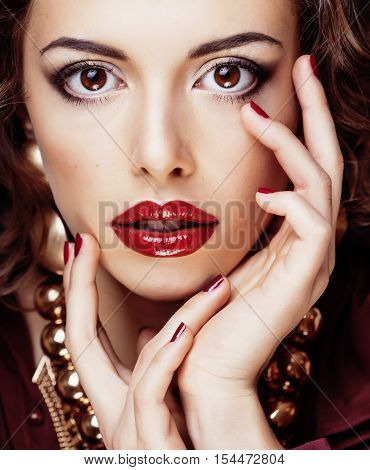 beauty rich brunette woman with a lot of jewellery, hispanic curly lady