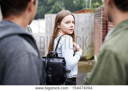 Teenage Girl Feeling Intimidated As She Walks Home