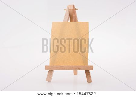 Brown Color  Notepaper On A Painting Tripod
