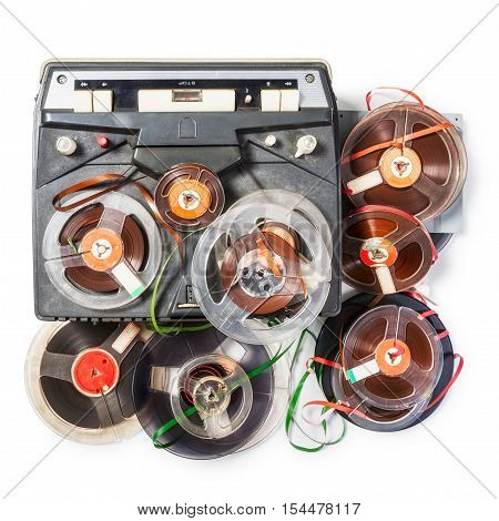 Vintage portable tape recorder and audio reels collection. Objects group isolated on white background with clipping path. Retro technology